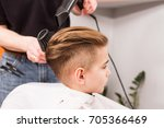 little boy getting haircut by... | Shutterstock . vector #705366469