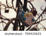 the lock on a tree of love for... | Shutterstock . vector #705415651