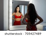 beautiful young woman in a sexy ... | Shutterstock . vector #705427489