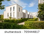 modern townhouses in a... | Shutterstock . vector #705444817