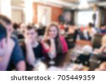 blurred people in the banquet... | Shutterstock . vector #705449359