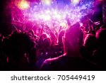 crowd with raised hands at... | Shutterstock . vector #705449419