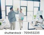team work concept. two friendly ...   Shutterstock . vector #705453235