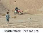 back of small boy looking at a... | Shutterstock . vector #705465775