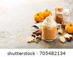 pumpkin spice latte in a glass... | Shutterstock . vector #705482134