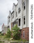 Small photo of UNIVERSITY PARK, IL - JULY 4, 2016: Speculative housing subdivision in disrepair that was never completed due to the Stock Market crash of 2008.