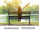 woman sitting relaxing and hand ... | Shutterstock . vector #705530245