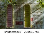 two windows of an abandoned... | Shutterstock . vector #705582751