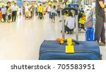 blue suitcase with yellow tag... | Shutterstock . vector #705583951