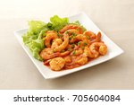 shrimp with chili sauce | Shutterstock . vector #705604084
