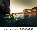 woman paddles kayak in the calm ... | Shutterstock . vector #705606751
