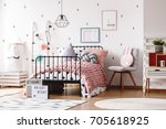 colorful pillows on knit pink... | Shutterstock . vector #705618925