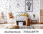 teddy bear on chair next to bed ... | Shutterstock . vector #705618979