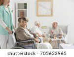 nurse helps happy senior on... | Shutterstock . vector #705623965