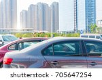 cars in parking lot | Shutterstock . vector #705647254