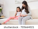 pregnant woman sitting on a... | Shutterstock . vector #705664021