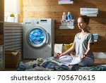 tired woman housewife in stress ... | Shutterstock . vector #705670615