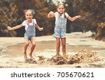 happy funny sisters twins ... | Shutterstock . vector #705670621