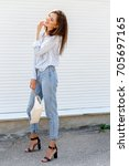 young stylish woman wearing...   Shutterstock . vector #705697165