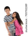 asian girl hugging her brother... | Shutterstock . vector #705702289