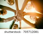 young group are join hands for...   Shutterstock . vector #705712081
