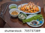 cooked prawns and oysters with... | Shutterstock . vector #705737389