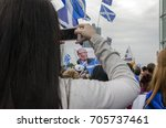 Small photo of GLASGOW, SCOTLAND, UK - SEPTEMBER 14 2014: A woman taking a photograph of the demonstration against the 'biased' coverage from the BBC during the Scottish Independence Referendum.