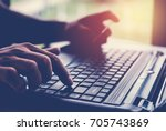hands holding credit card and...   Shutterstock . vector #705743869