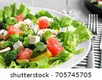 plate with broccoli salad on... | Shutterstock . vector #705745705