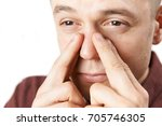 studio shot of man suffering... | Shutterstock . vector #705746305