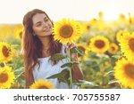 beautiful young girl enjoying... | Shutterstock . vector #705755587