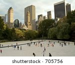 This is a shot of people enjoying early season skating at the Wollman Rink in Central Park. - stock photo