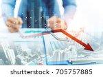 businessman point at decreasing ... | Shutterstock . vector #705757885