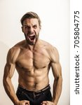 strong man. angry man | Shutterstock . vector #705804775