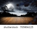 wooden table with dark sky and... | Shutterstock . vector #705806125