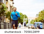 front view of an athletic man... | Shutterstock . vector #705812899
