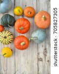 pumpkins and squashes on wooden ... | Shutterstock . vector #705827305