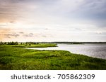 lush pond at sunset east coast... | Shutterstock . vector #705862309
