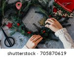 making christmas wreath | Shutterstock . vector #705870619