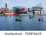paddle boaters in baltimore... | Shutterstock . vector #705876619