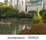 A view of a pond in Central Park with a backdrop of the city. - stock photo