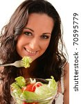 Young smiling woman holding salad bowl with variety of fresh raw vegetables. Eating food. - stock photo