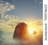 Businessman Climb A Mountain T...