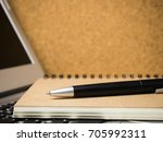 pen and brown notebook on... | Shutterstock . vector #705992311