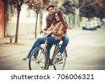 young couple riding bicycle at... | Shutterstock . vector #706006321