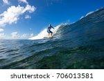 muscular surfer riding on big... | Shutterstock . vector #706013581