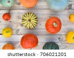 pumpkins and squashes on wooden ... | Shutterstock . vector #706021201