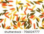 multicolored pasta on a white...   Shutterstock . vector #706024777