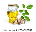 moringa oleifera oil with seeds ... | Shutterstock . vector #706030747