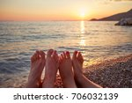 Couple Lying On The Beach At...